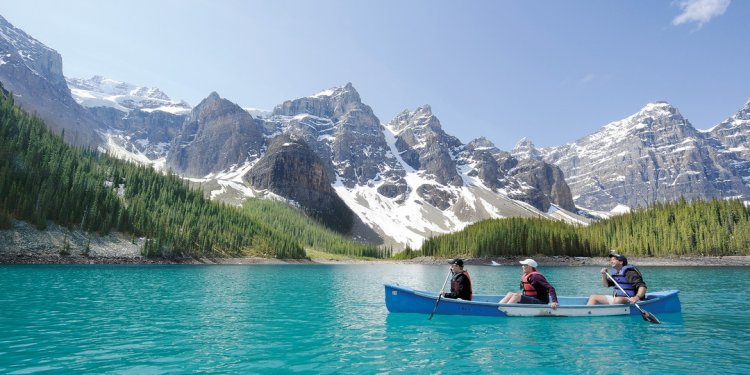Three tourists canoe across