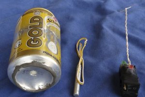 A photo published in Islamic State mag Dabiq reveals a can of Schweppes Gold soda and what looked like a detonator and activate a blue back ground
