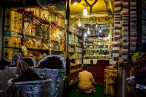 a store owner prays inside their store in the Old marketplace area in Sharm El Sheikh, Egypt