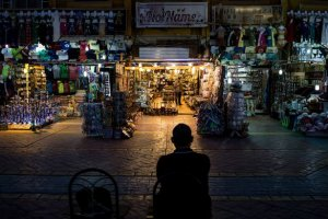 A shop owner waits for customers into the Old marketplace region in Sharm El Sheikh, Egypt