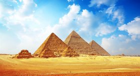 Giza area with Great pyramids with blue cloudy sky