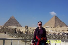 standing at the egyptian pyramids at Giza plus the sphinx