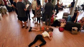 Tourists wait within airport of Egypt's Red water resort of Sharm El-Sheikh
